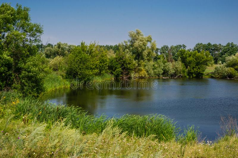 Lake in the village landscape at a daytime stock photography