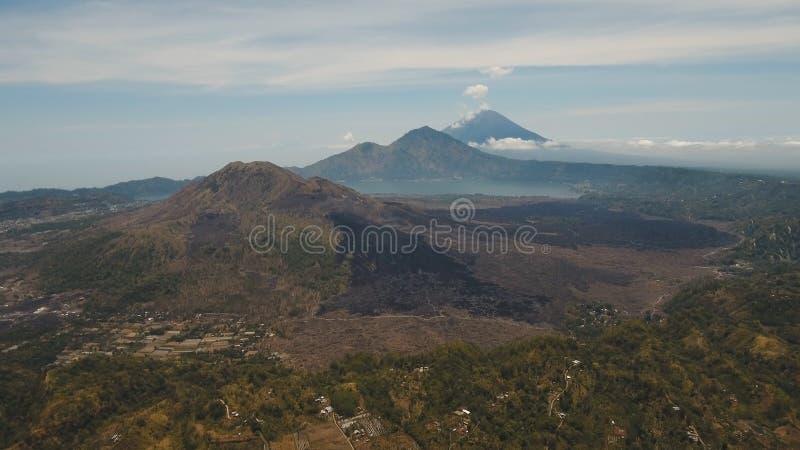 Lake and volcano Batur, Agung. Bali,Indonesia. Aerial view crater lake Batur, volcanoes Batur, Agung. Bali, Indonesia. Mountain landscape with volcanoes, lake royalty free stock photography