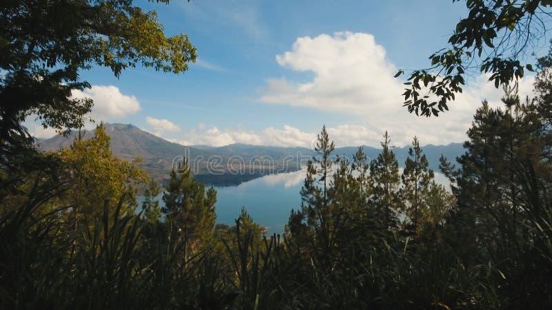 Lake and volcano Batur. Bali,Indonesia. Aerial view Mountains, volcanoes, crater lake Batur, Bali, Indonesia. Mountain landscape with volcanoes, lake, sky and stock photos