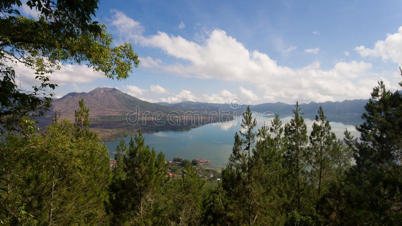 Lake and volcano Batur. Bali,Indonesia. Aerial view Mountains, volcanoes, crater lake Batur, Bali, Indonesia. Mountain landscape with volcanoes, lake, sky and royalty free stock photography