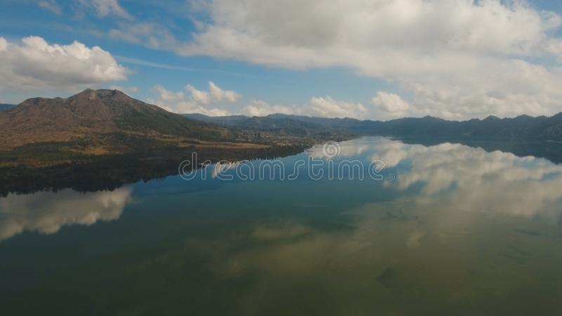 Lake and volcano Batur. Bali,Indonesia. Aerial view Mountains, volcanoes, crater lake Batur, Bali, Indonesia. Mountain landscape with volcanoes, lake, sky and stock photography