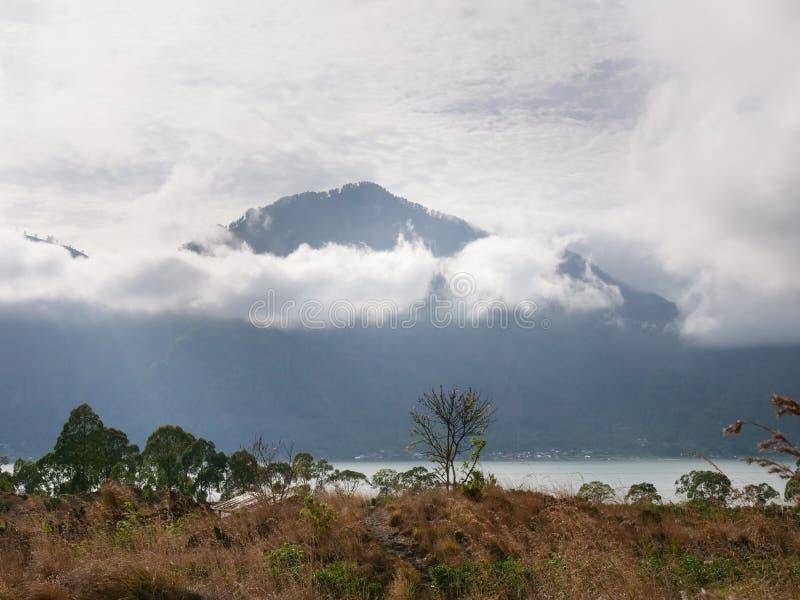 Lake in the volcano crater. Batur, Bali. Lake Batur in the crater of a volcano. Volcano mount and lake Batur located in Kintamani area in Bali, Indonesia stock images