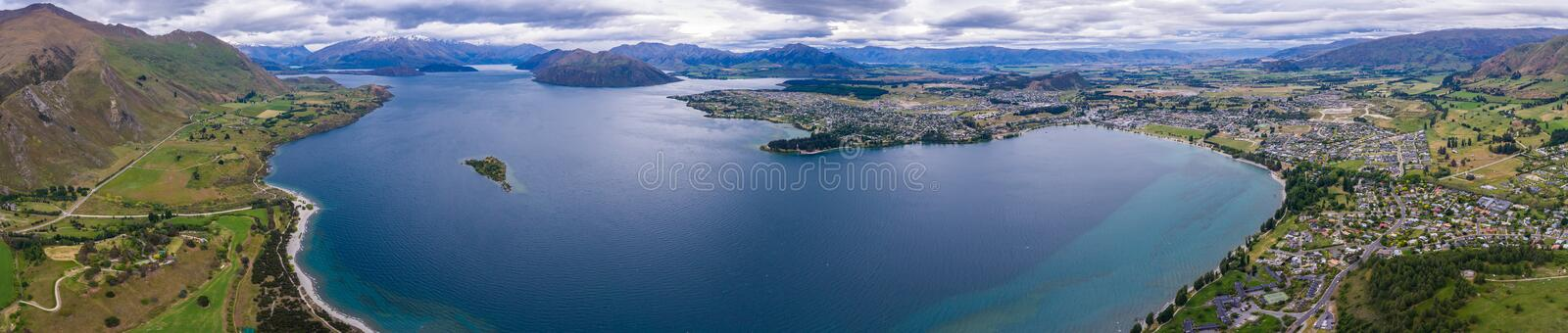 Lake Wanaka, New Zealand Panoramic Landscape. From aerial view captured by drone flying above Wanaka City. Wanaka is a popular resort of New Zealand, and is stock images