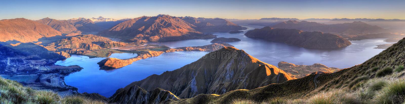 Lake Wanaka panorama, New Zealand. The beautiful lake Wanaka seen from the summit of Roy peak, New Zealand stock image