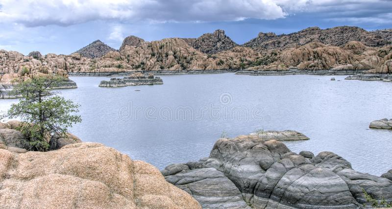 Lake Watson Granite Dells, Prescott Arizona USA. Rain clouds over granite cliffs and boulders of Watson Lake and distant mountains. Lake Watson is one of two royalty free stock images