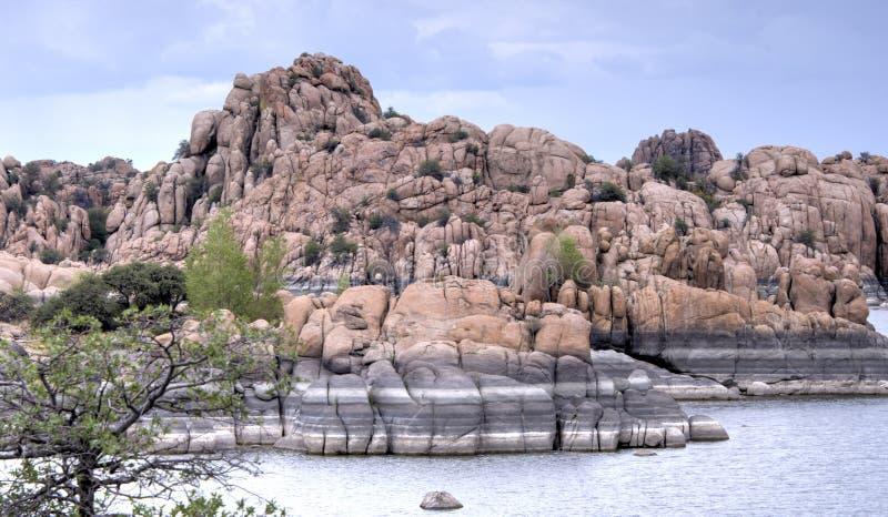 Lake Watson Granite Dells, Prescott Arizona USA. Rain clouds over granite cliffs and boulders of Watson Lake and distant mountains. Lake Watson is one of two stock image
