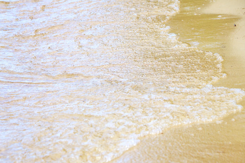 Lake wave sand. Lake sea ocean wave with foam washes beach sand. Nature wallpaper background stock image