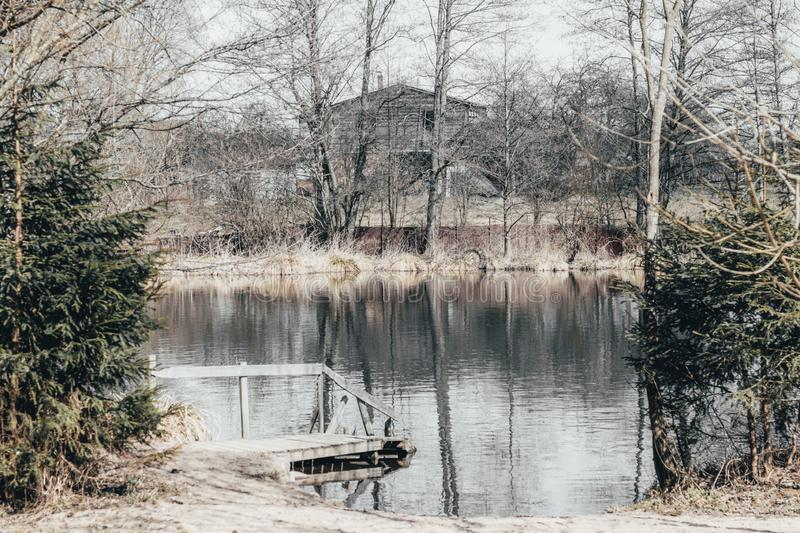 lake. wilderness house on the beach. have toning. almost black and white photo stock photos