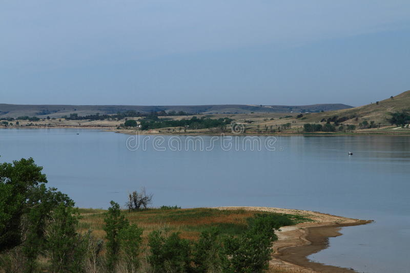 Lake Wilson In North Central Kansas. A wide angle photo of boats floating on the calm blue water of Lake Wilson in North Central Kansas. Blue skies, blue water stock photos
