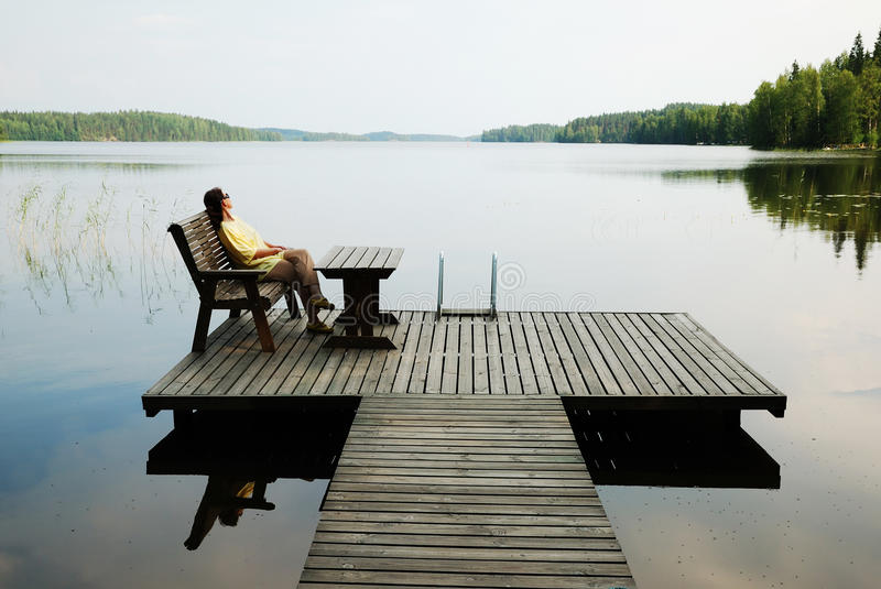 Download Lake With Wooden Platform And Woman Resting. Stock Photo - Image: 18117120