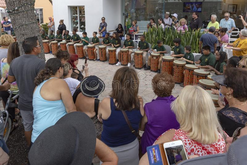 Lake Worth, Florida, USA Fab 23-24, 2019 25Th Annual Street Painting Fest. A local school band plays on a street corner with all playing the same kind of drum stock image