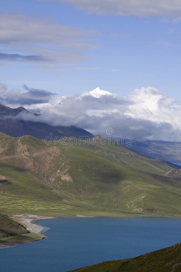 Lake Yamdrok Yumtso and snowy mountain royalty free stock photos