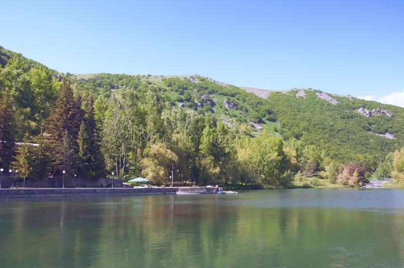 Lake Yotnabyur near the Hyatt Place Jermuk hotel. Green scenic mountains and clear blue sky. Armenia stock photo