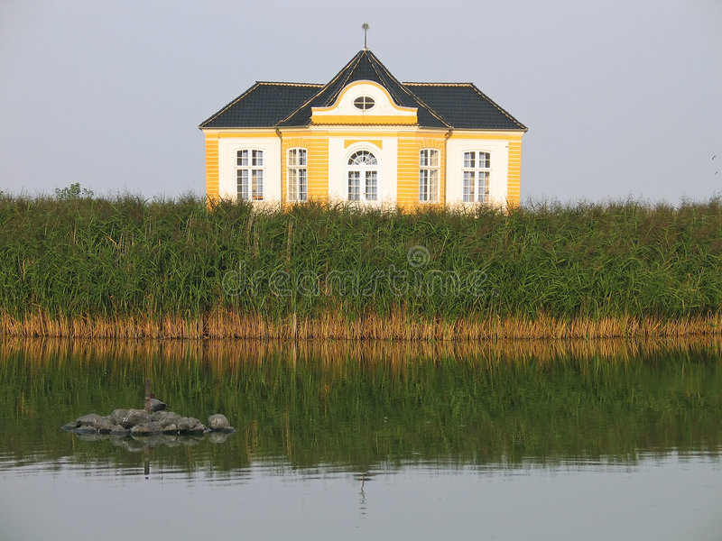 Lakefront Property - summer house. Summer house by the lake - Valdemar Castle Denmark royalty free stock photography