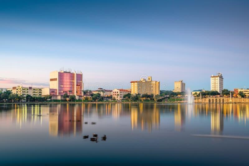 Lakeland, Florida, USA Skyline. Lakeland, Florida, USA downtown cityscape on the lake at twilight stock images