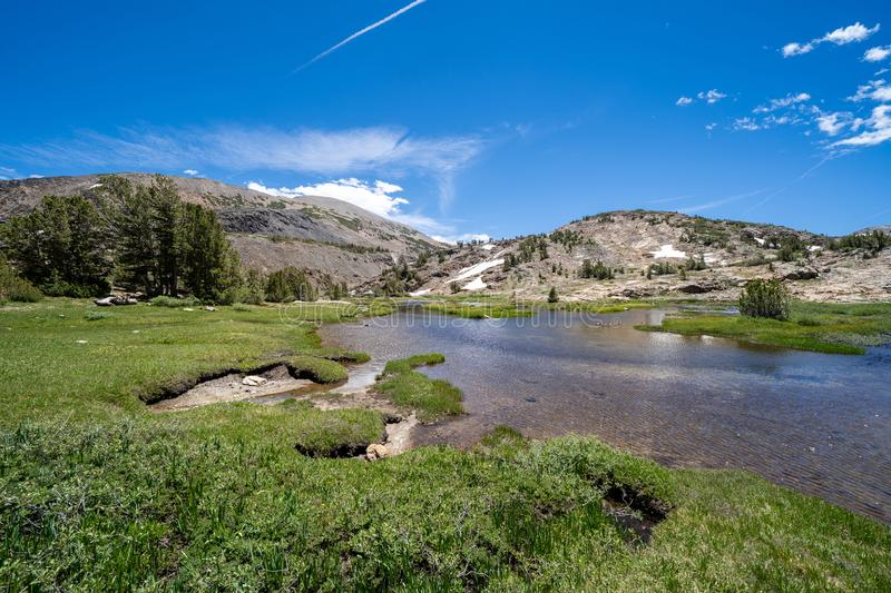 20 Lakes Basin backpacking and wilderness hiking the California Eastern Sierra Nevada Mountains in the summer. Hoover Wilderness. Area0 Lakes Basin hiking trail stock photo