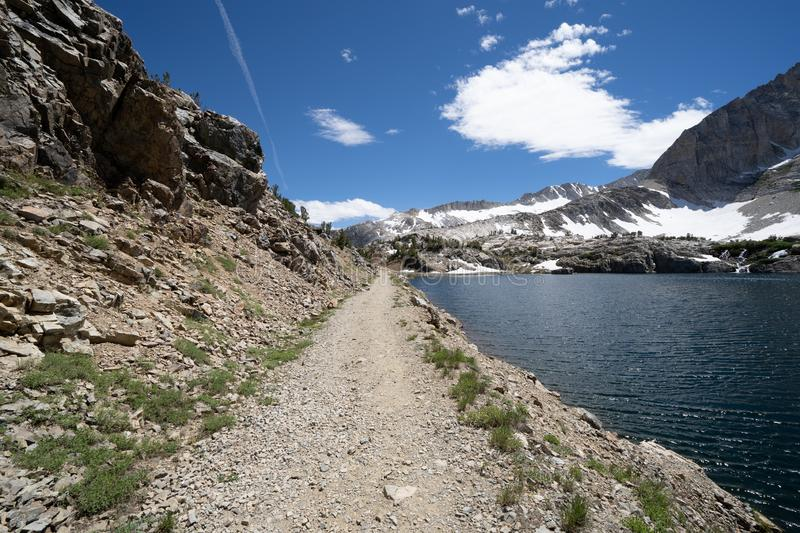 Trail through Steelhead Lake in 20 Lakes Basin hiking area in the Eastern Sierra Nevada Mountains of California. 20 Lakes Basin hiking trail in California in the royalty free stock photos