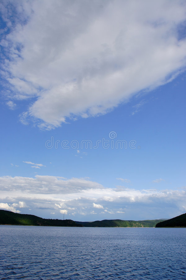 Lakes and skies royalty free stock photos