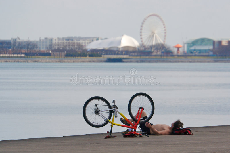 Lakeshore Biker Relaxing royalty free stock photography