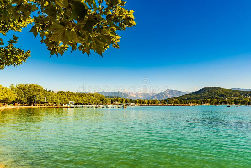Lakeside Holidays. Great lake Klagenfurt am Worthersee. The large lake of Klagenfurt in Austria. Many boats are anchored. Summer. Holiday resort of many stock photos