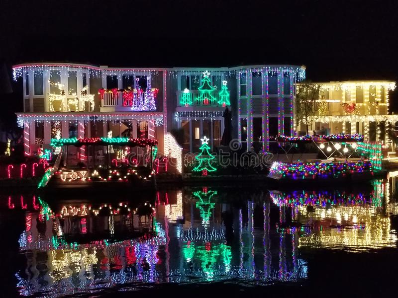 Lakeside Homes Decorated with Christmas Lights along East Lake Village in Yorba Linda California. Beautifully Decorated Homes with Christmas Lights Reflecting on royalty free stock images