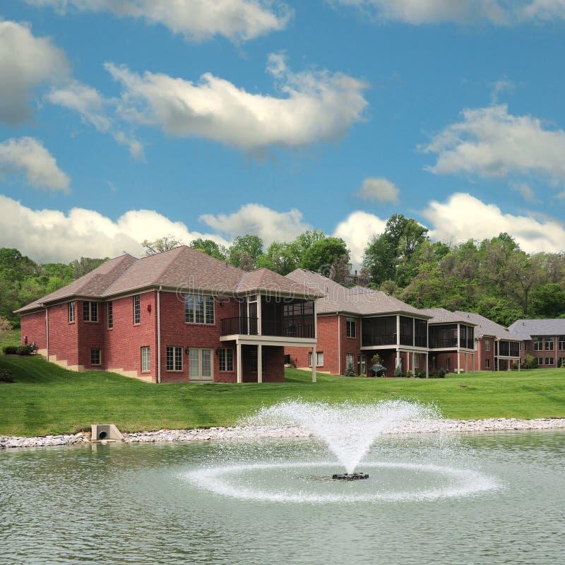 Download Lakeside Landominium Homes stock image. Image of porch - 5584499