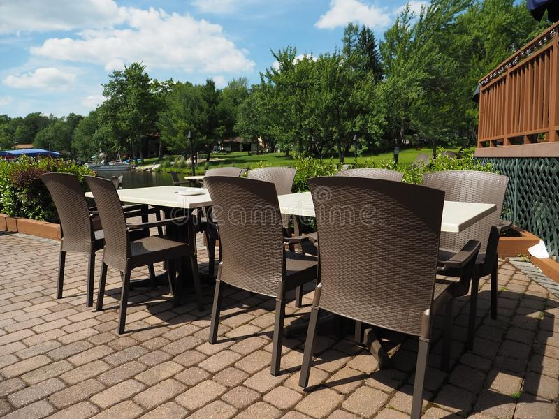 Lakeside Outdoor Patio Tables and Chairs royalty free stock images