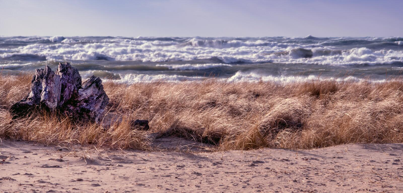 Lakeside panorama with wild waves stock photos