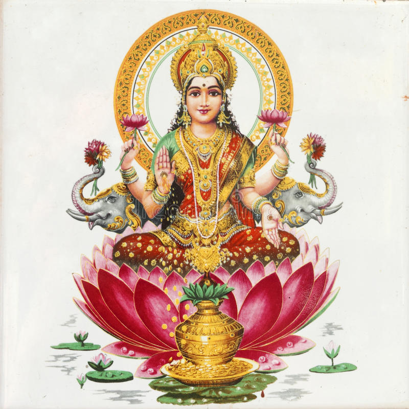 Lakshmi goddess. Ceramic tile with image of Lakshmi - Hindu goddess of wealth and prosperity sitting on flower of red lotus, India, Asia