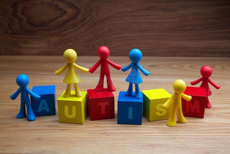 Lal dzieci tła projekt z autyzmu słowem na sześcianach zdjęcia stock