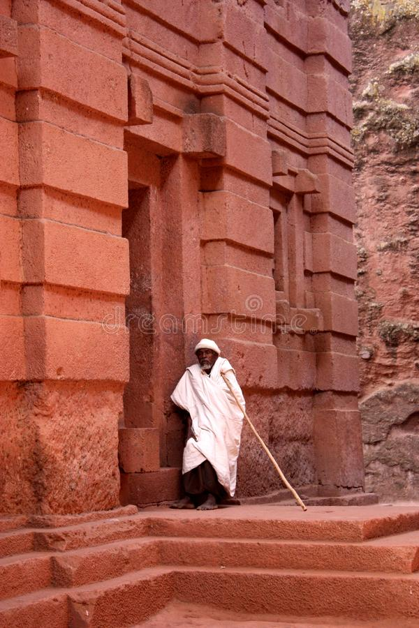 Lalibela. Old man waiting at the entrance of lalibela churches in ethiopia royalty free stock photos