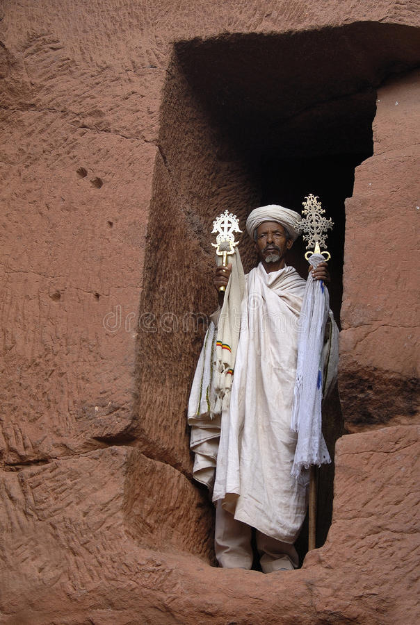 Lalibela Priest 1. Priest in a rock-hewn church of in Lalibela, Northern Ethiopia stock image