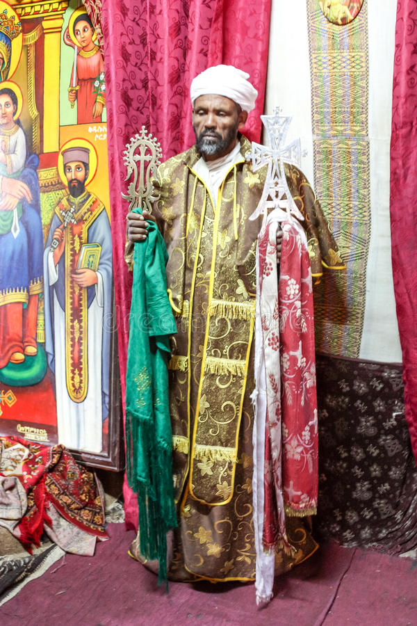Lalibela. Priest showing a holy cross in a rock-carvest church in Lalibela in Ethiopia stock photo