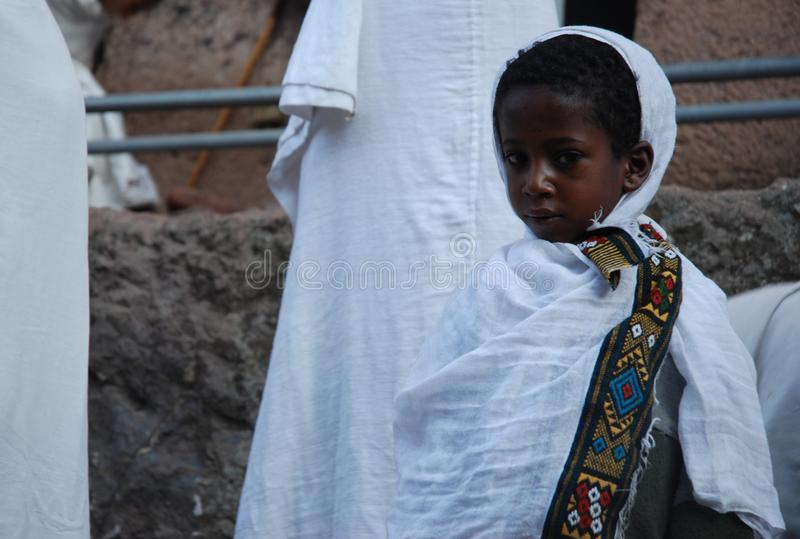Lalibela, Wollo, Ethiopia, circa February 2007: Boy attending religious service royalty free stock photos