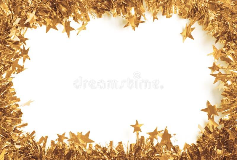 Lamé dell'oro di Natale come un confine ha isolato immagini stock