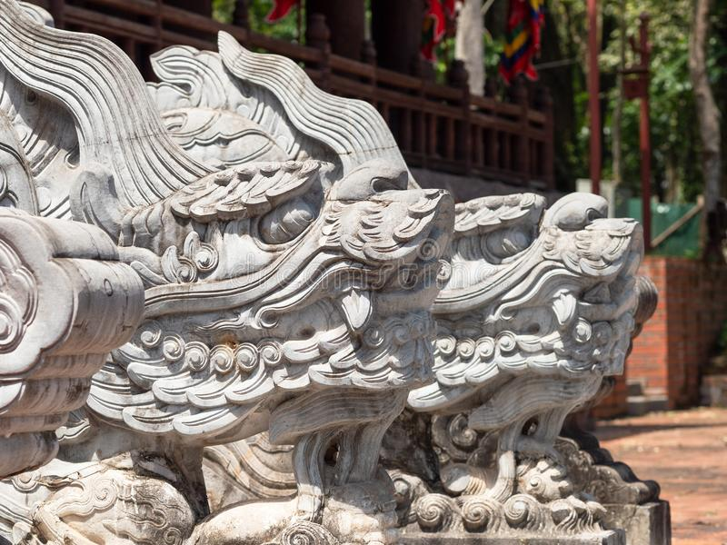 Lam Kinh temple in Thanh Hoa, Vietnam. Dragon heads at the Lam Kinh temple in Xuan Lam and Lam Son townlet of Tho Xuan district, Thanh Hoa, Vietnam. The temple stock photo