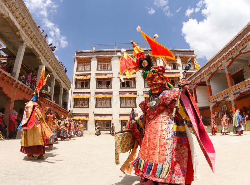 Monks perform a religious masked and costumed mystery dance of Tibetan Buddhism at the traditional Cham Dance Festival. Lamayuru, India - June 16, 2012 royalty free stock image