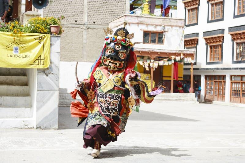 LAMAYURU, INDIA - SETEMBER 13, 2015: An unidentified buddhist lamas dressed in mystical mask dancing Tsam mystery dance in time of royalty free stock image