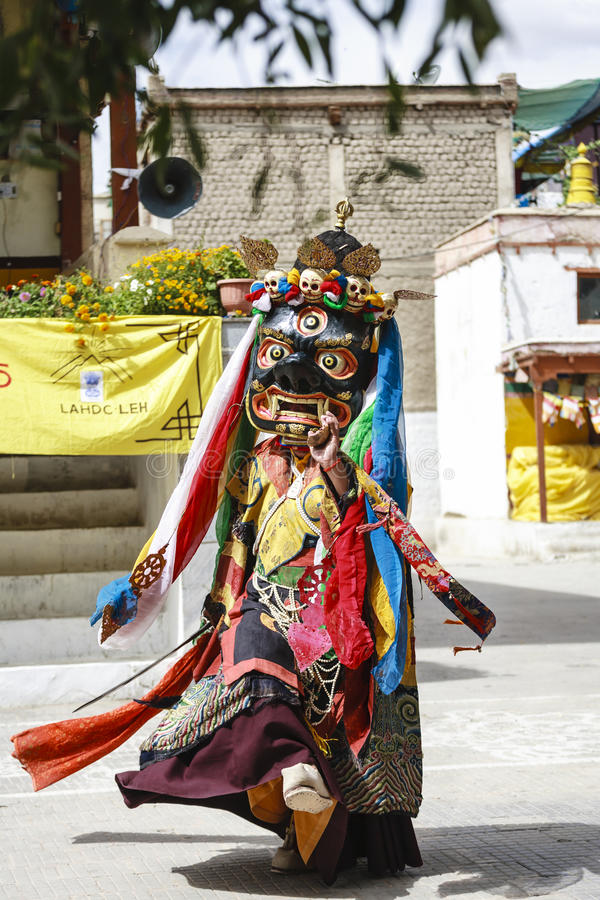 LAMAYURU, INDIA - SETEMBER 13, 2015: An unidentified buddhist lamas dressed in mystical mask dancing Tsam mystery dance in time of stock images
