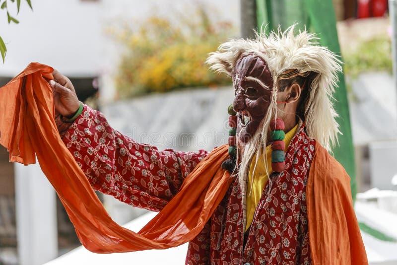 LAMAYURU, INDIA - SETEMBER 13, 2015: An unidentified buddhist lamas dressed in mystical mask dancing Tsam mystery dance in time of royalty free stock photo