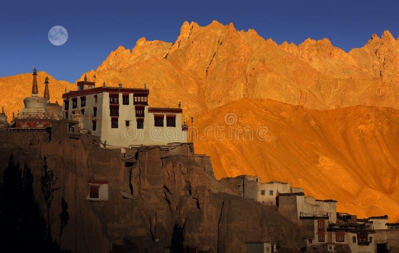 Lamayuru monastery, Ladakh. Lamayuru monastery, mountain range, sunset and full moon, Ladakh, India royalty free stock photos