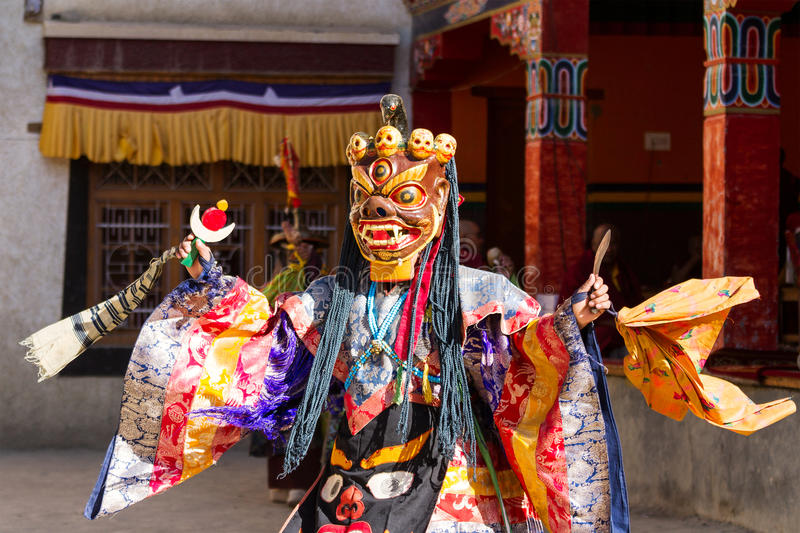 Lamayuru. Monk in mask performs buddhist sacred cham dance. Unidentified monk in mask performs a religious masked and costumed mystery dance of Tibetan Buddhism stock photos