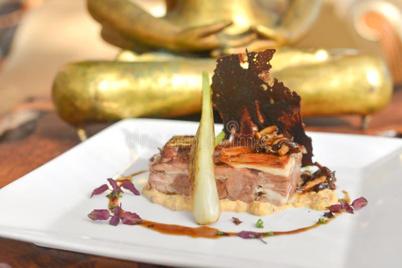 Lamb and Beetroot Asian Fusion Dish. Asian fusion dish of lamb saddle with beetroot waffle and sauce picante stock images