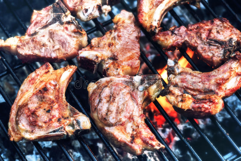 Lamb chops cooking on barbecue grill for summer outdoor party. F stock photo
