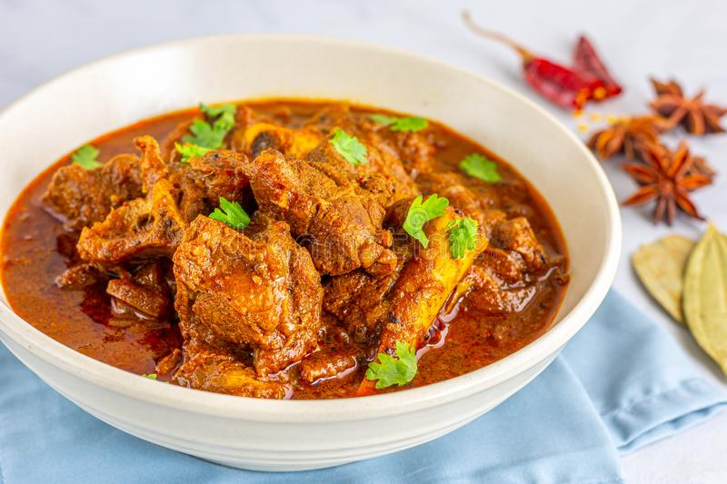 Lamb Curry / Mutton Curry - Traditional and Spicy Indian Lamb Dish. Authentic Lamb Vindaloo Traditional Fiery Red Indian / Goan Curry of Lamb stock image