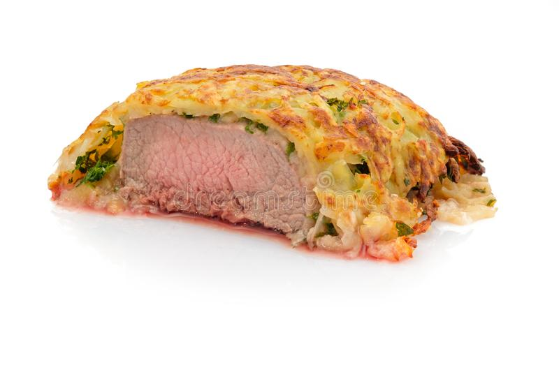 Lamb filet with potato crust and herbs royalty free stock image