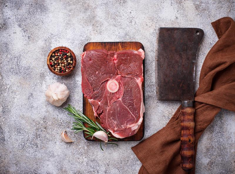 Lamb meat with rosemary, spices and cleaver. royalty free stock photography