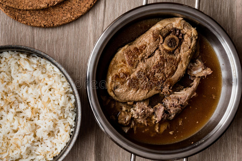 Lamb meat tandoori with rice in pan. Mother`s food stock image
