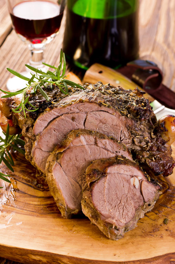 Lamb Roast. As closeup on a wooden board royalty free stock images