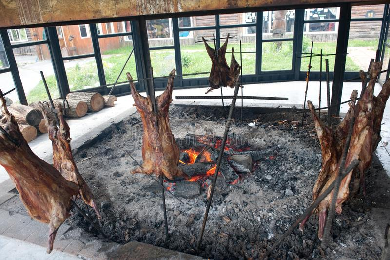 Lamb roasted over open fire and charcoal, Argentina. Lamb Barbecue, roasted over charcoal and open fire in Argentina, South America royalty free stock photography